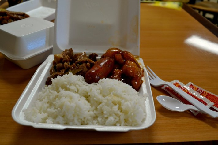 The two entree combo included steamed rice, longanisa sausage, pork adobo and sesame chicken.