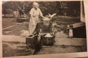 My great-great-grandma Martha Marcusson loved to be clean, ride her motorcycle and was an immigrant from Denmark. Here she is pictured with a washing machine, a remarkable appliance at the time.
